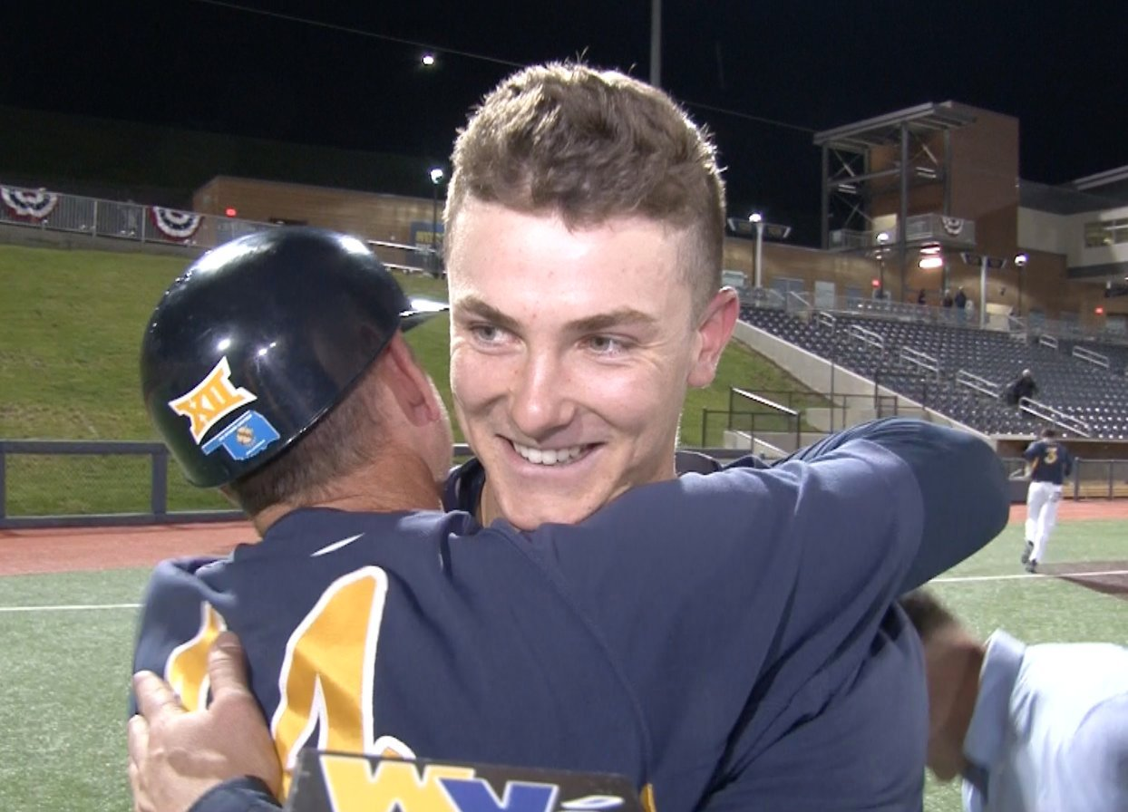 WVU baseball coach Randy Mazey hugs Jackson Cramer after his walk-off home run to beat No. 16 Oklahoma State.