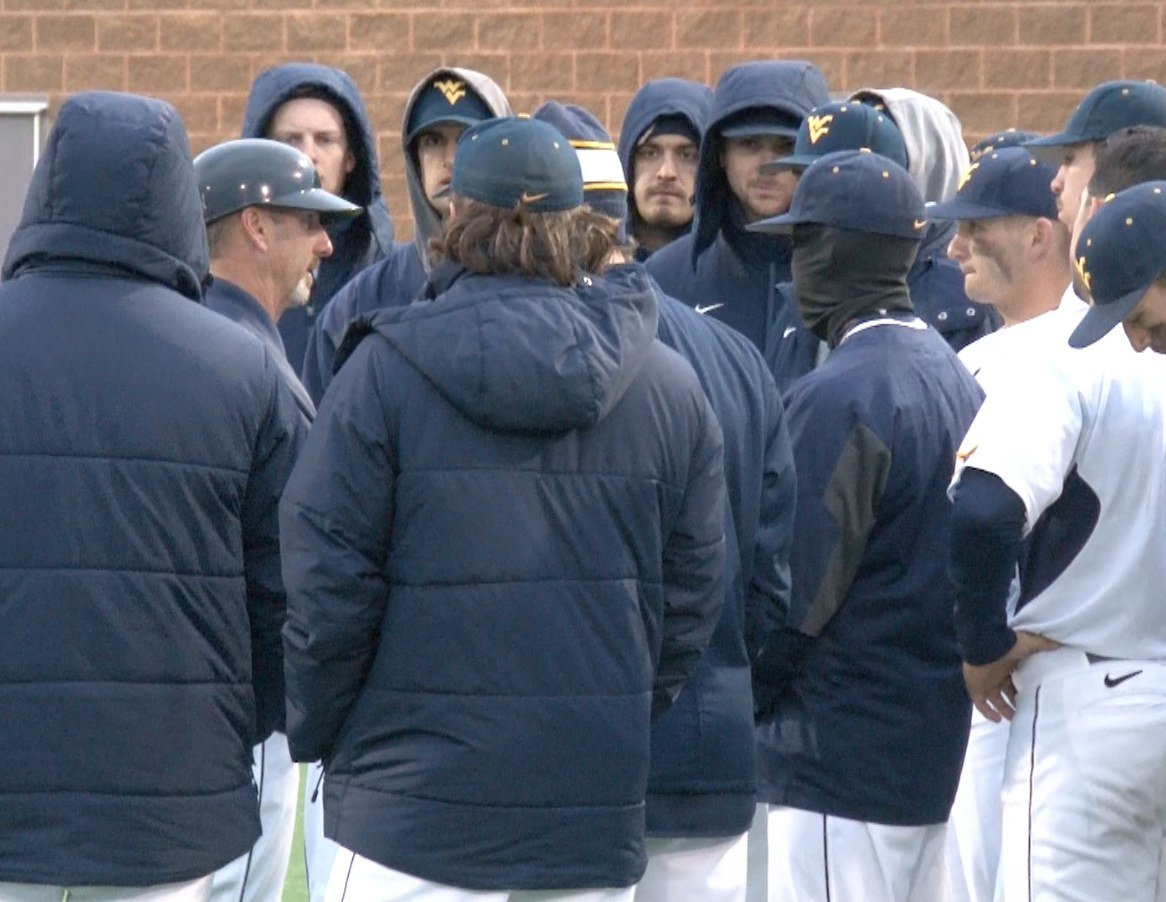Randy Mazey gathers the Mountaineers for a post game talk after falling to Furman 7-3 on Friday evening.