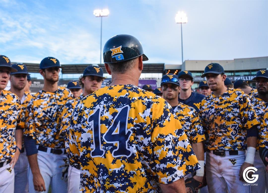 WVU baseball coach Randy Mazey talks with his team after a 9-4 win over Texas Tech in the Big 12 Tournament (PHOTO: Geoff Coyle)