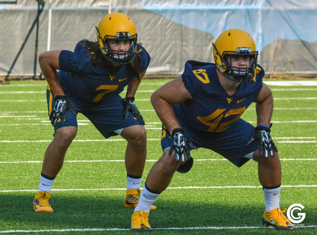 Freshman linebacker Brendan Ferns, left, lines up for the first practice of WVU camp in 2016. (PHOTO: Geoff Coyle)