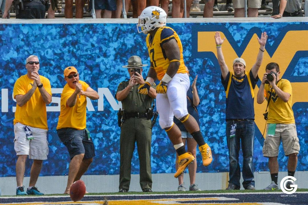 WVU running back Rushel Shell celebrates the first touchdown of the 2016 Mountaineer football season. (PHOTO: Emily Coyle)