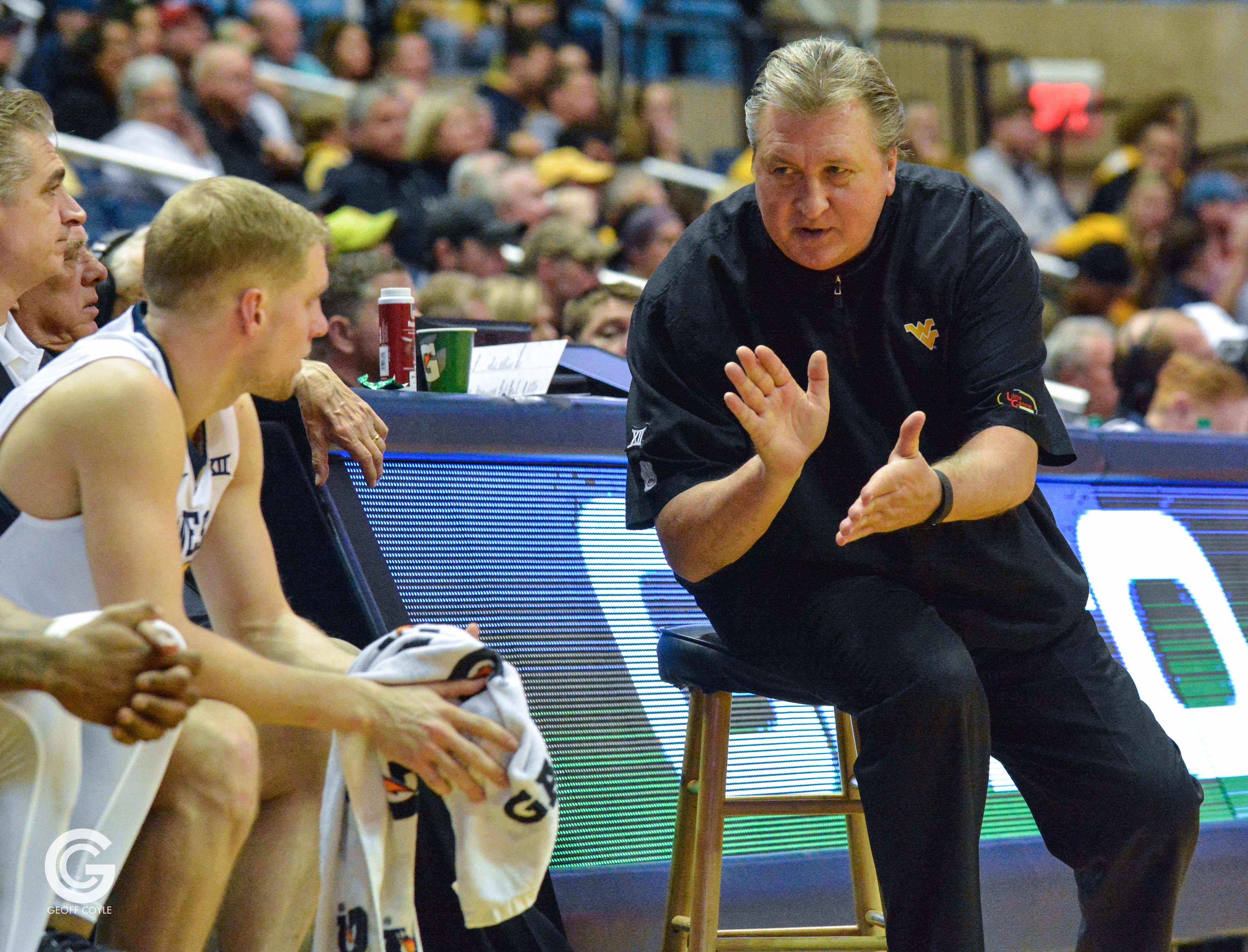 WVU coach Bob Huggins tries to motivate his bench during the second half of a win over Radford. (PHOTO: Geoff Coyle)