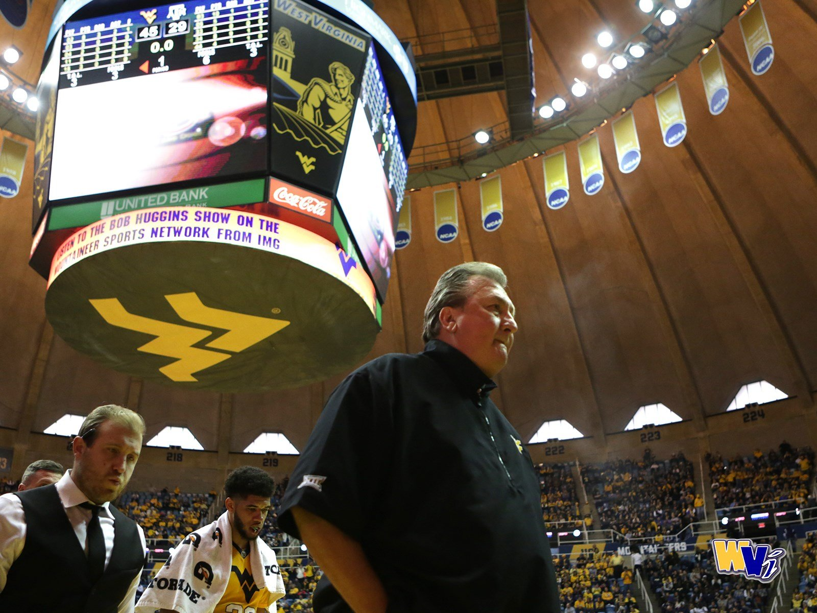 Coach Huggins walks off the court following Saturday's victory over Texas A&M.