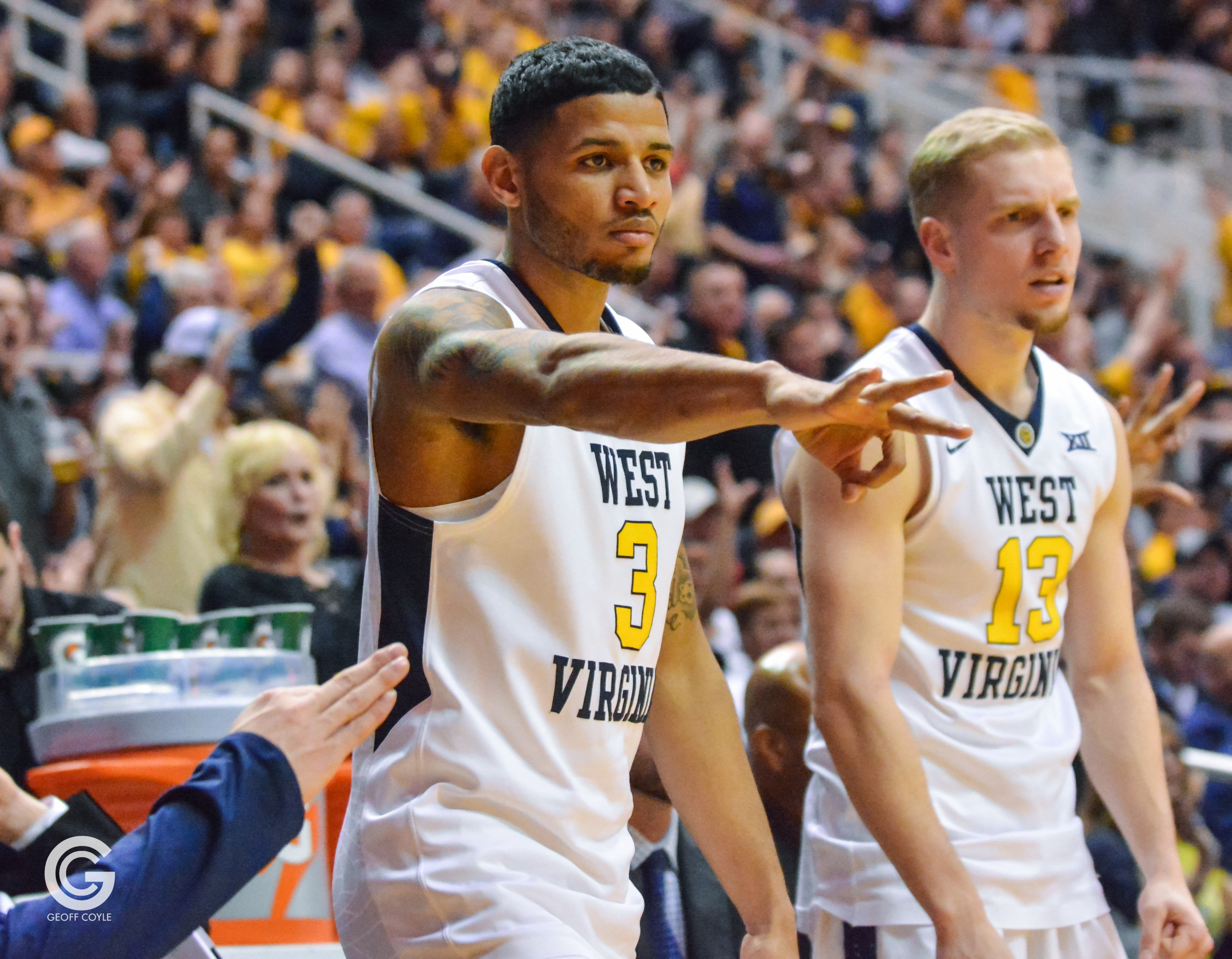 "James ""Beetle"" Bolden signals a 3-pointer for the Mountaineers. (PHOTO: Geoff Coyle)"