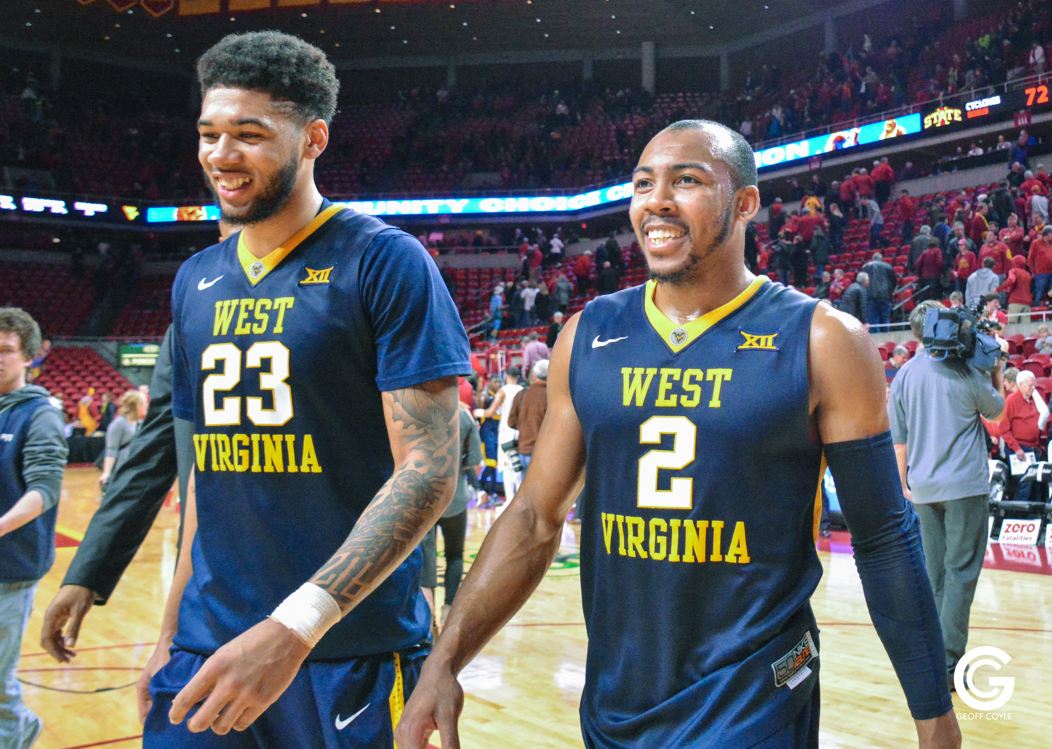 Esa Ahmad and Jevon Carter look to sweep Kansas Monday night in Lawrence. (PHOTO: Geoff Coyle)