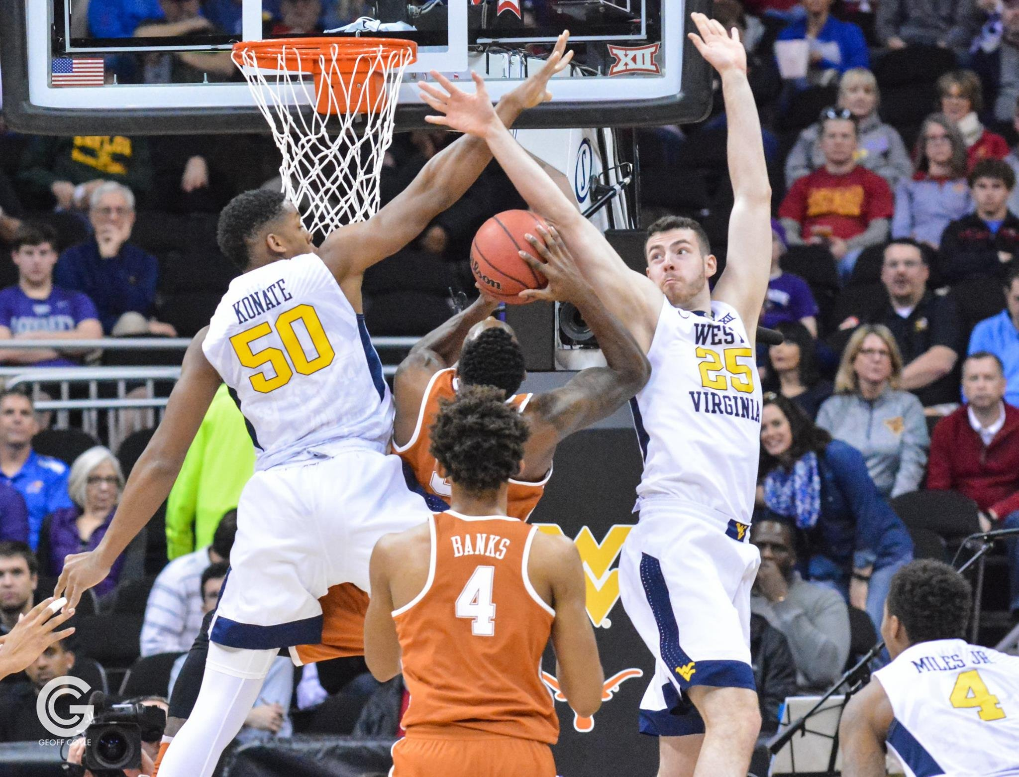 Freshman Sagaba Konate and Maciej Bender block a shot in the quarterfinal round of the Phillips 66 Big 12 Men's Basketball Championship.