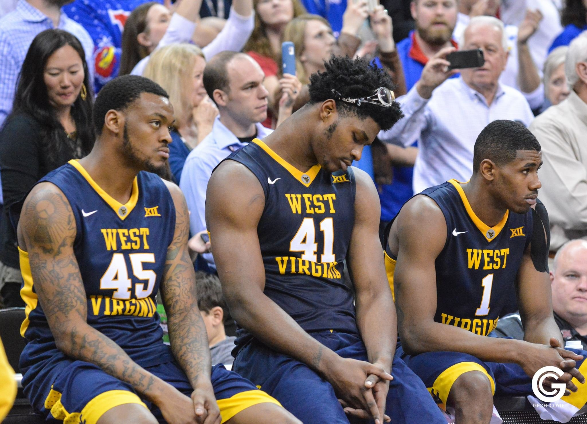 WVU players Elijah Macon, Devin Williams and Jonathan Holton watch the trophy presentation after suffering an 81-71 loss to Kansas in the 2016 Big 12 Championship. (PHOTO: Geoff Coyle)
