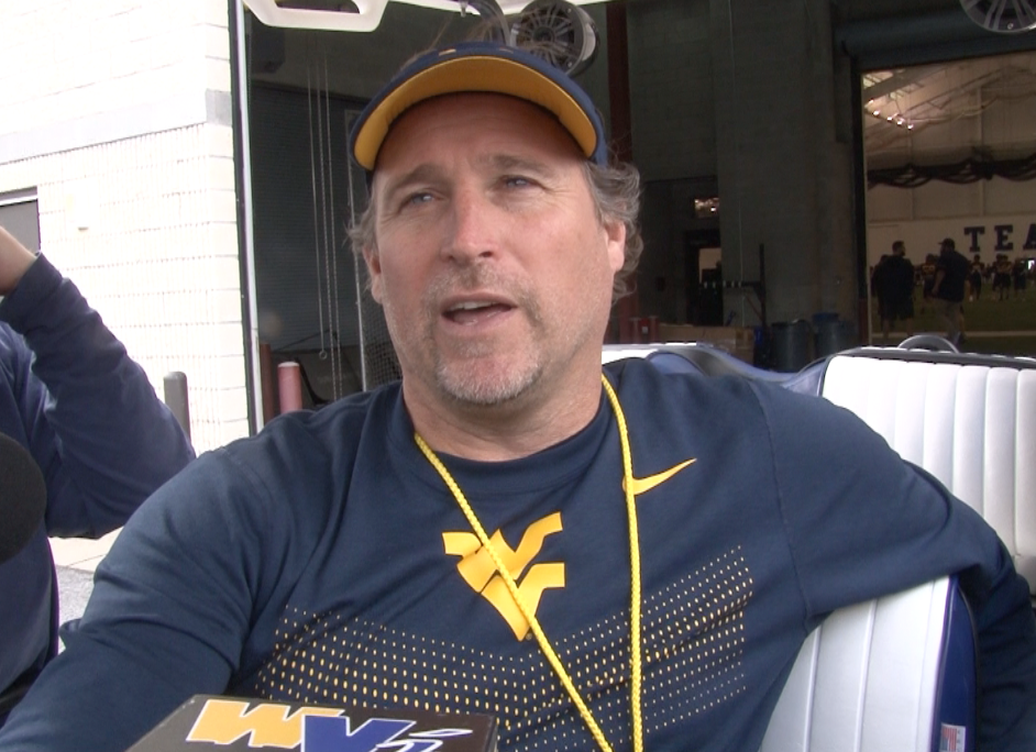 Dana Holgorsen speaks with reporters ahead of Tuesday's practice in Morgantown.