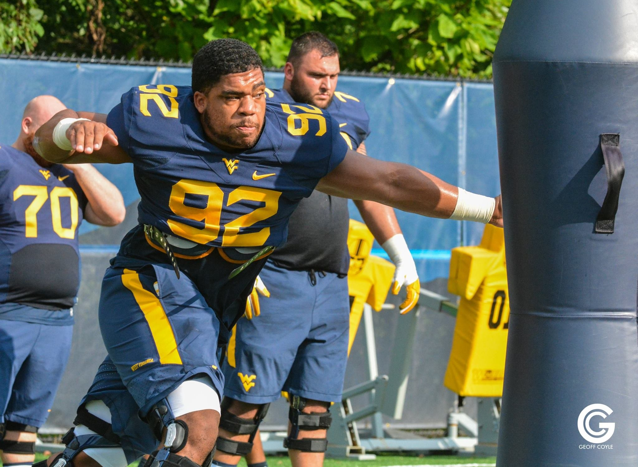 University High School graduate Jon Lewis works a defensive line drill in Morgantown. (PHOTO: Geoff Coyle)