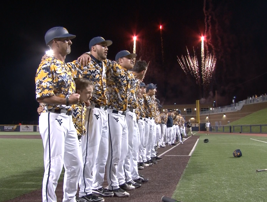 Randy Mazey and the Mountaineers sign Country Roads following a 5-4 win over No. 2 TCU.