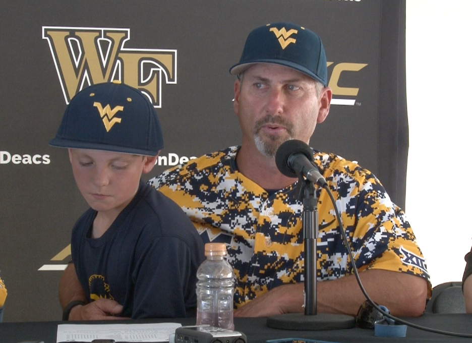 Randy Mazey and his son, Weston, take questions after a 9-1 WVU win over Maryland.