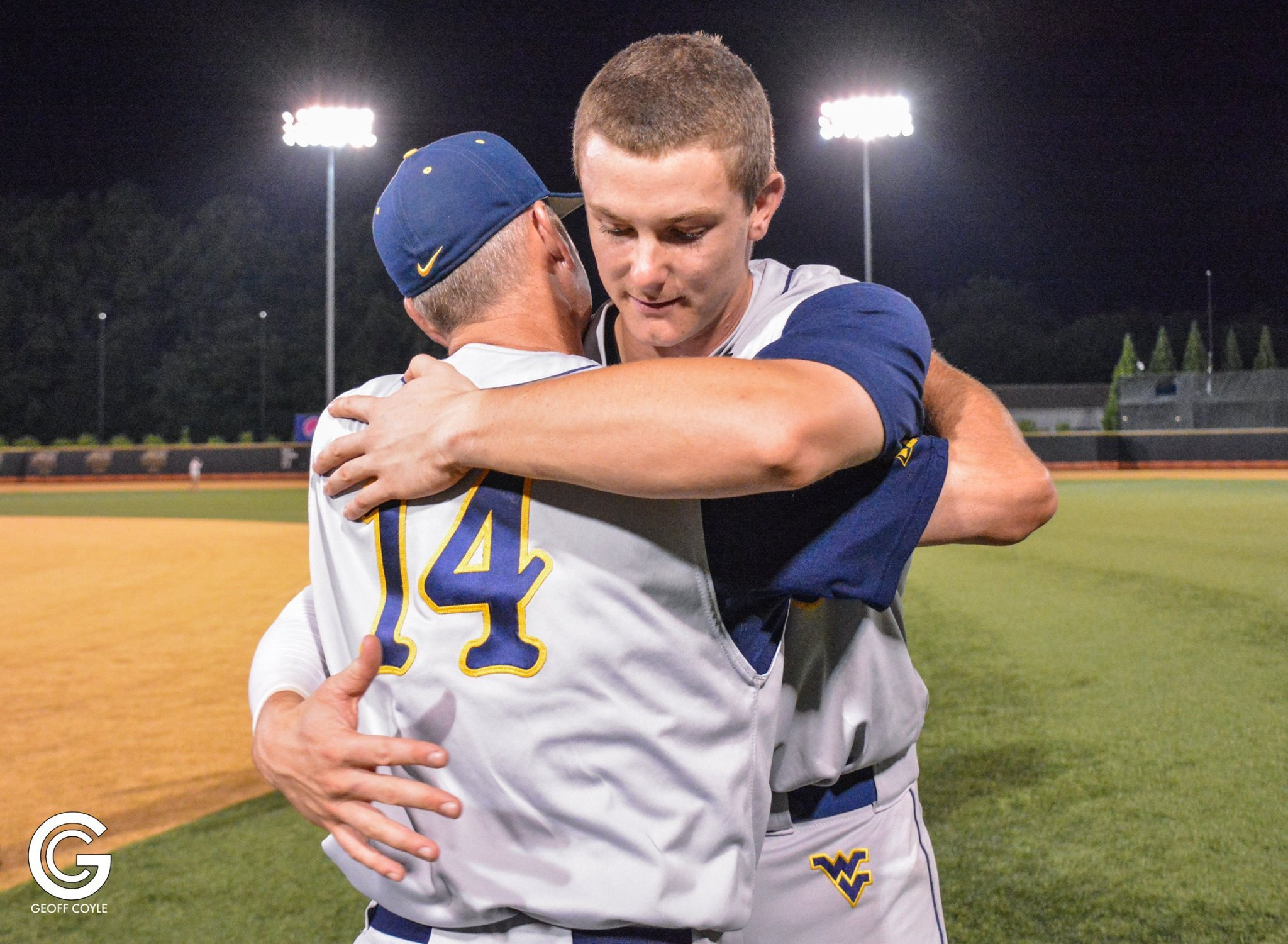 WVU senior Jackson Cramer hugs his head coach, Randy Mazey, after playing the final game of his collegiate career at the NCAA Regional. (PHOTO: Geoff Coyle)