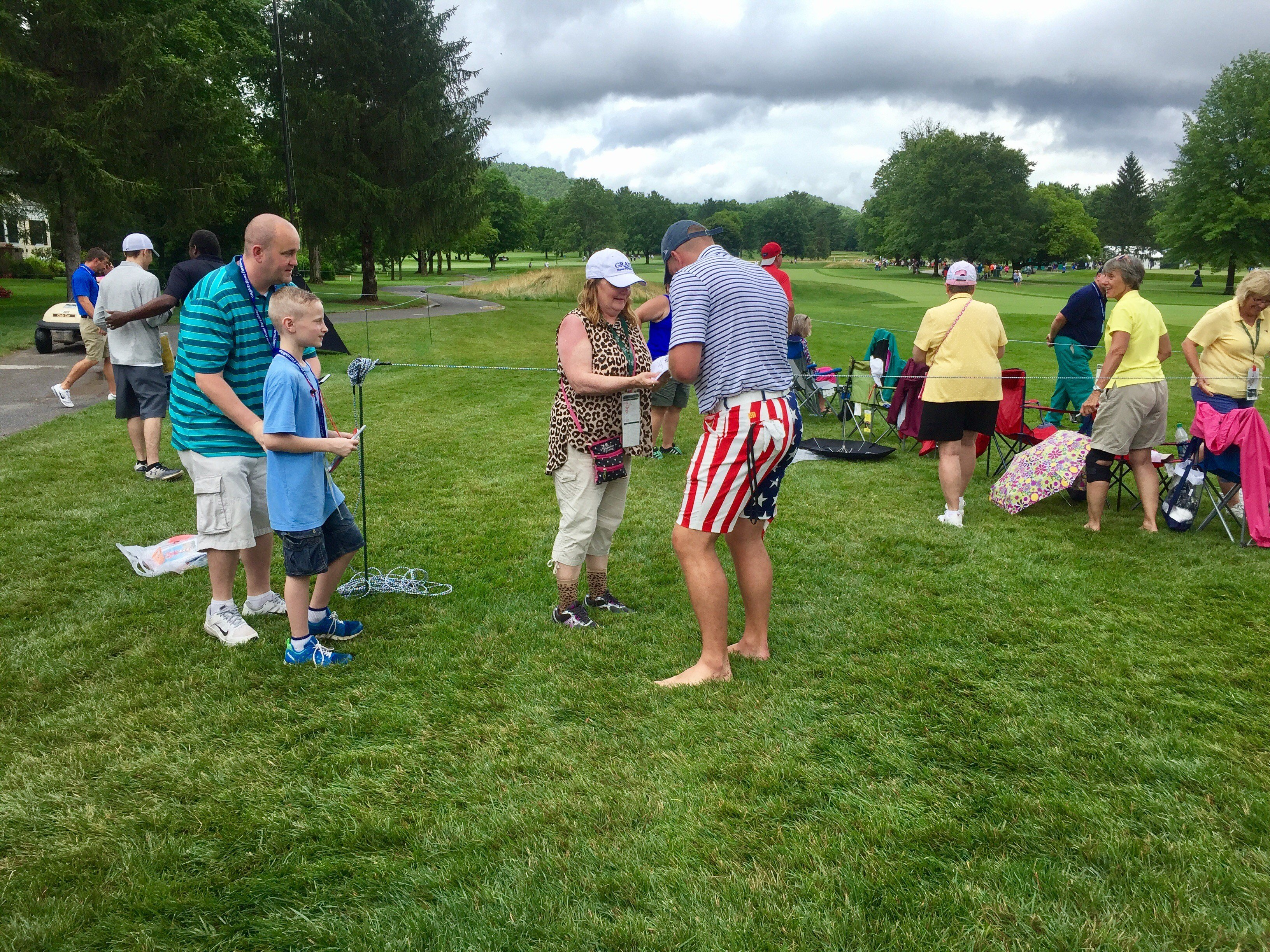 Former WVU kicker/punter Pat McAfee signs autogrpahs during Wednesday's Pro-Am. (PHOTO: Anjelica Trinone)