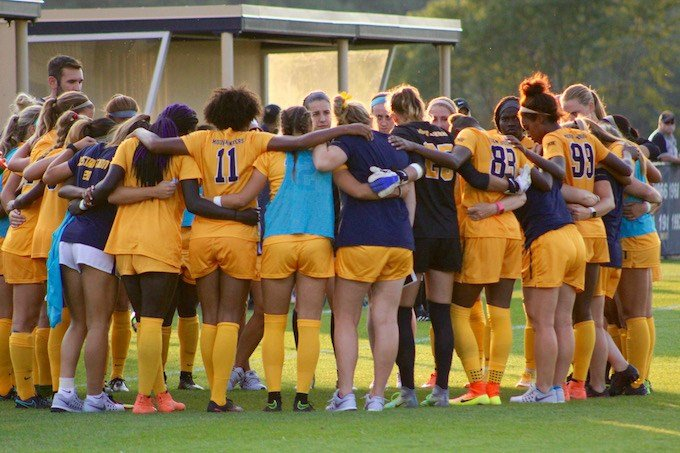 The WVU women's soccer team prepares to take the field. (PHOTO: Anjelica Trinone)