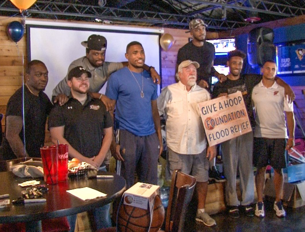 Former WVU basketball players join Da'Sean Butler at Playoffs Bar and Grill to collect donations for flood relief.