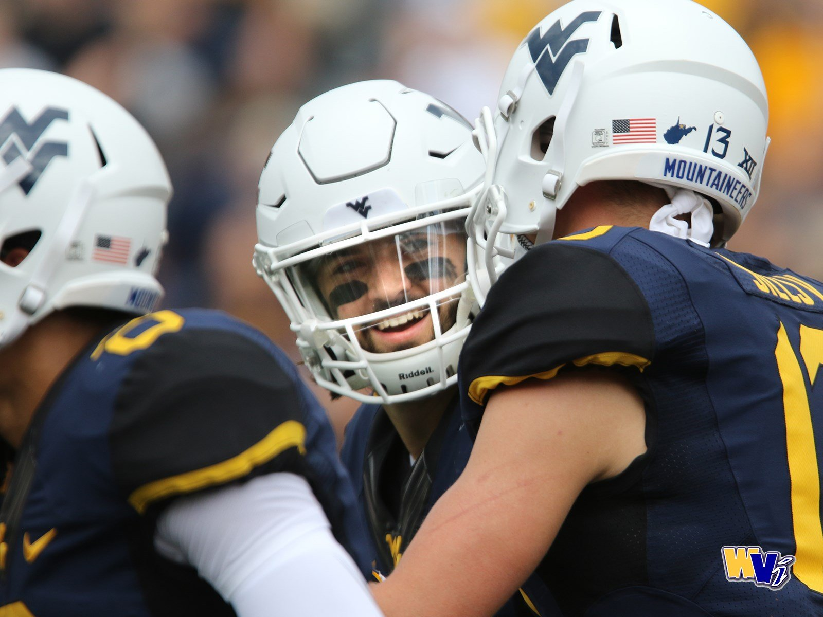 WVU quarterback Will Grier talks with receiver David Sills during Saturday's game against Delaware St. game.