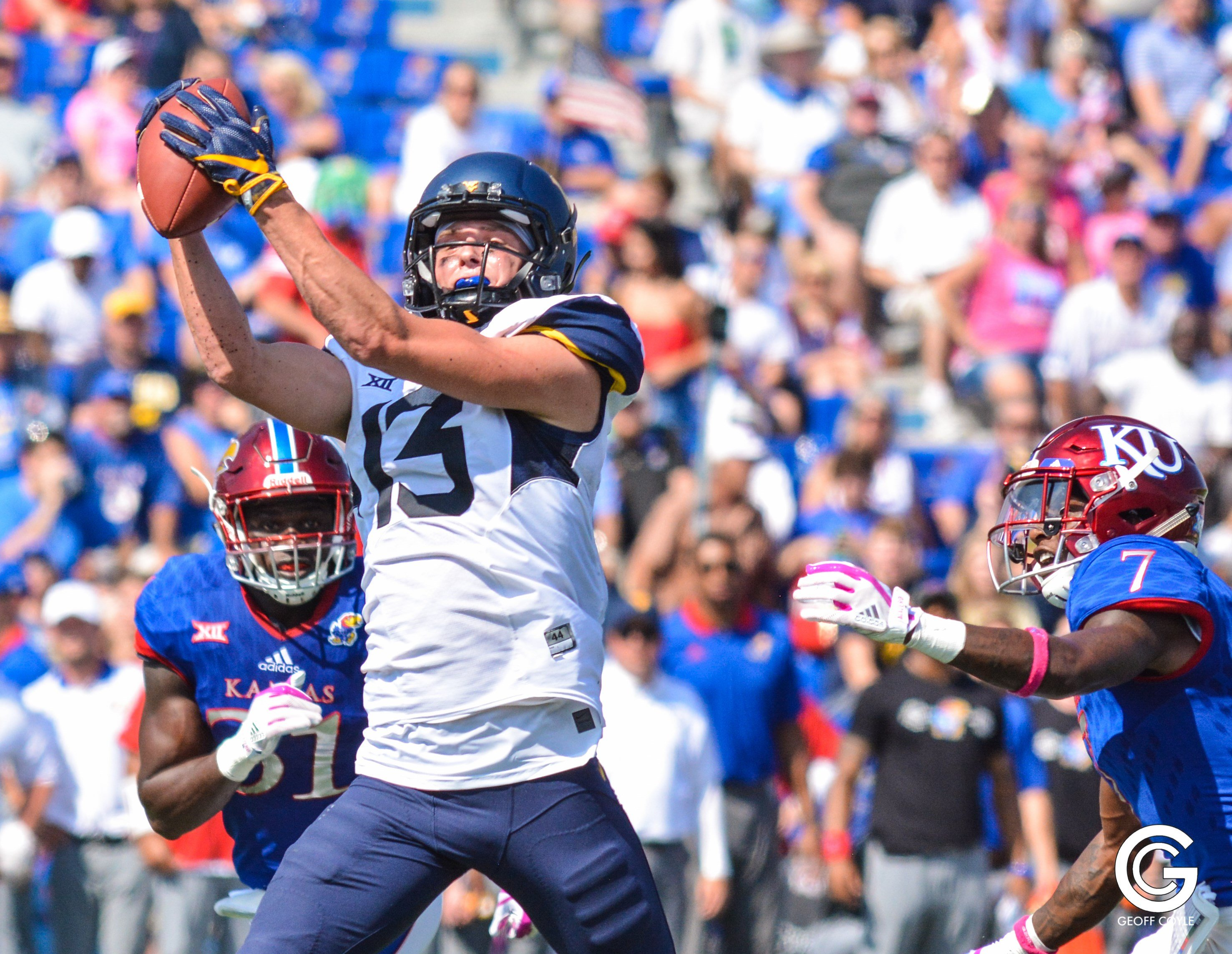 David Sills reels in a 49-yard touchdown reception, his first of two scores in a 56-34 WVU win over Kansas. (PHOTO: Geoff Coyle)