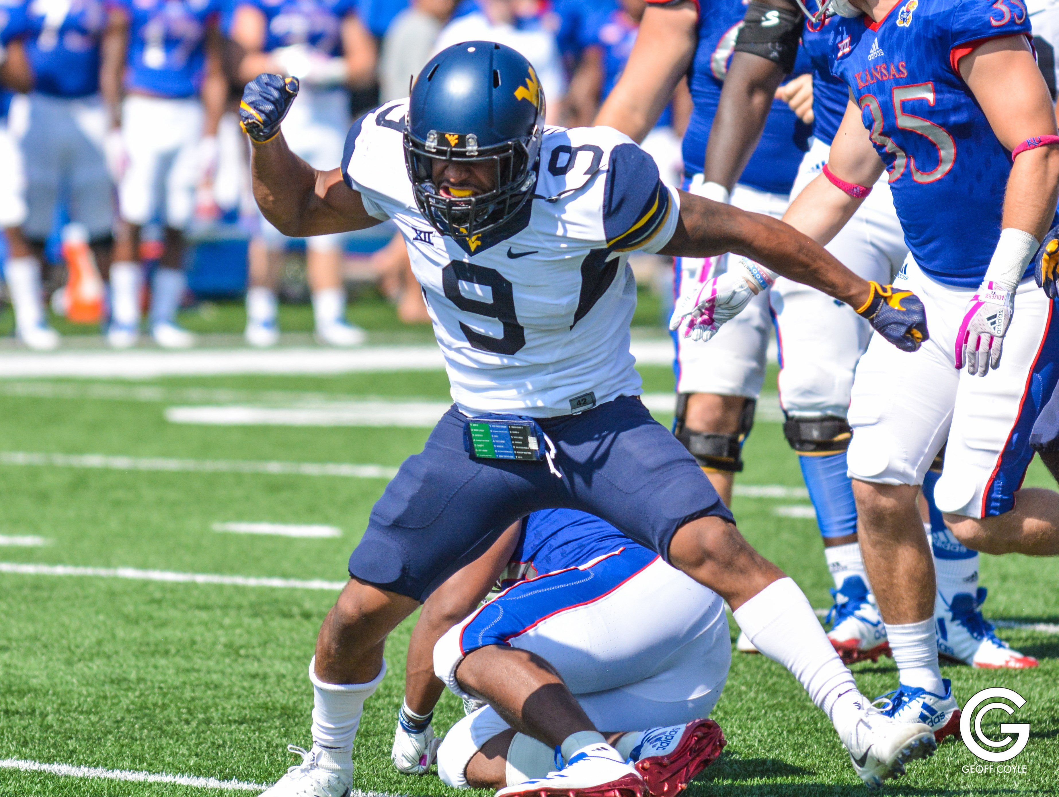 WVU sophomore safety JoVanni Stewart celebrates a tackle for a loss in a 56-34 victory over Kansas. (PHOTO: Geoff Coyle)