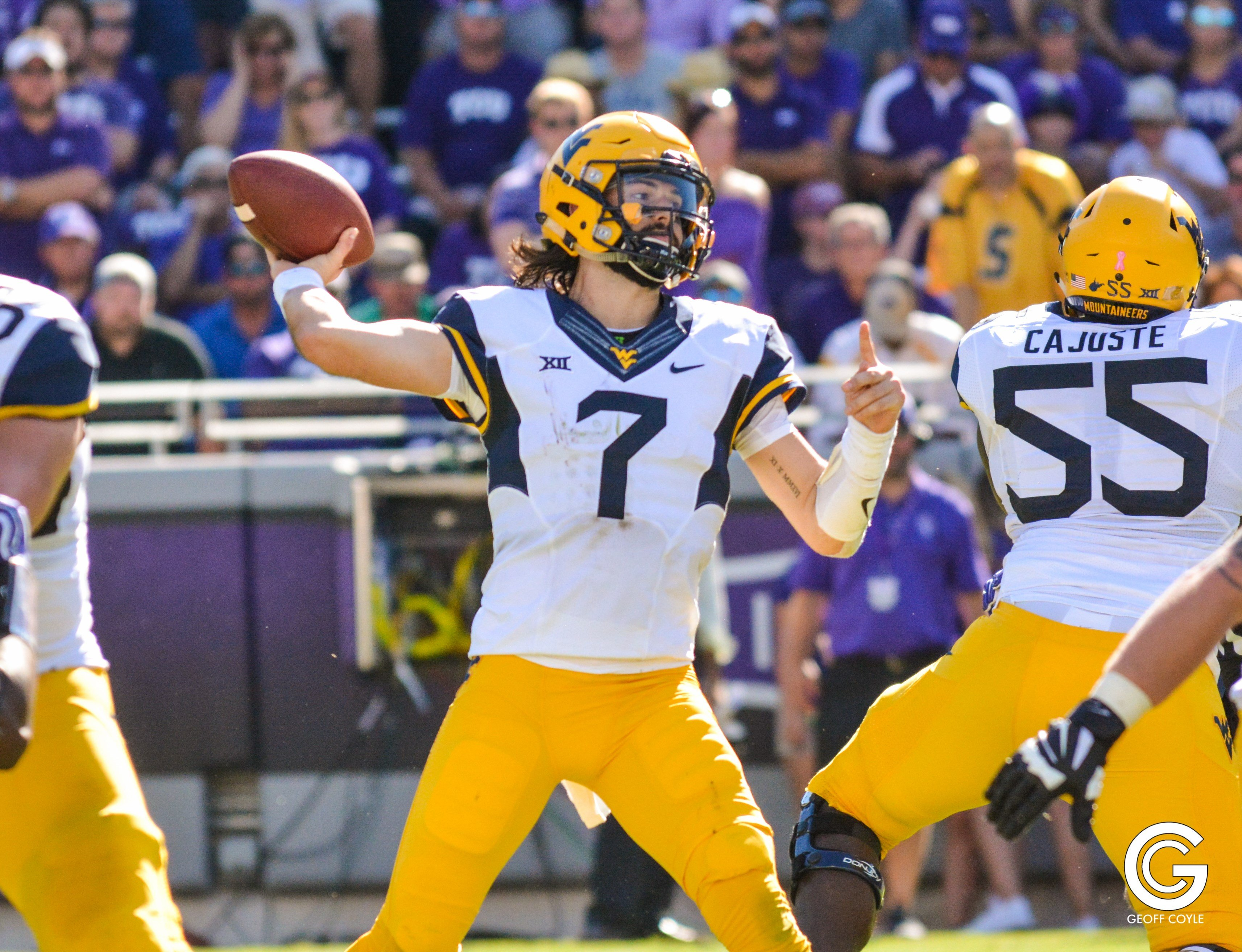 Will Grier eyes a receiver down field against TCU. (PHOTO: Geoff Coyle)