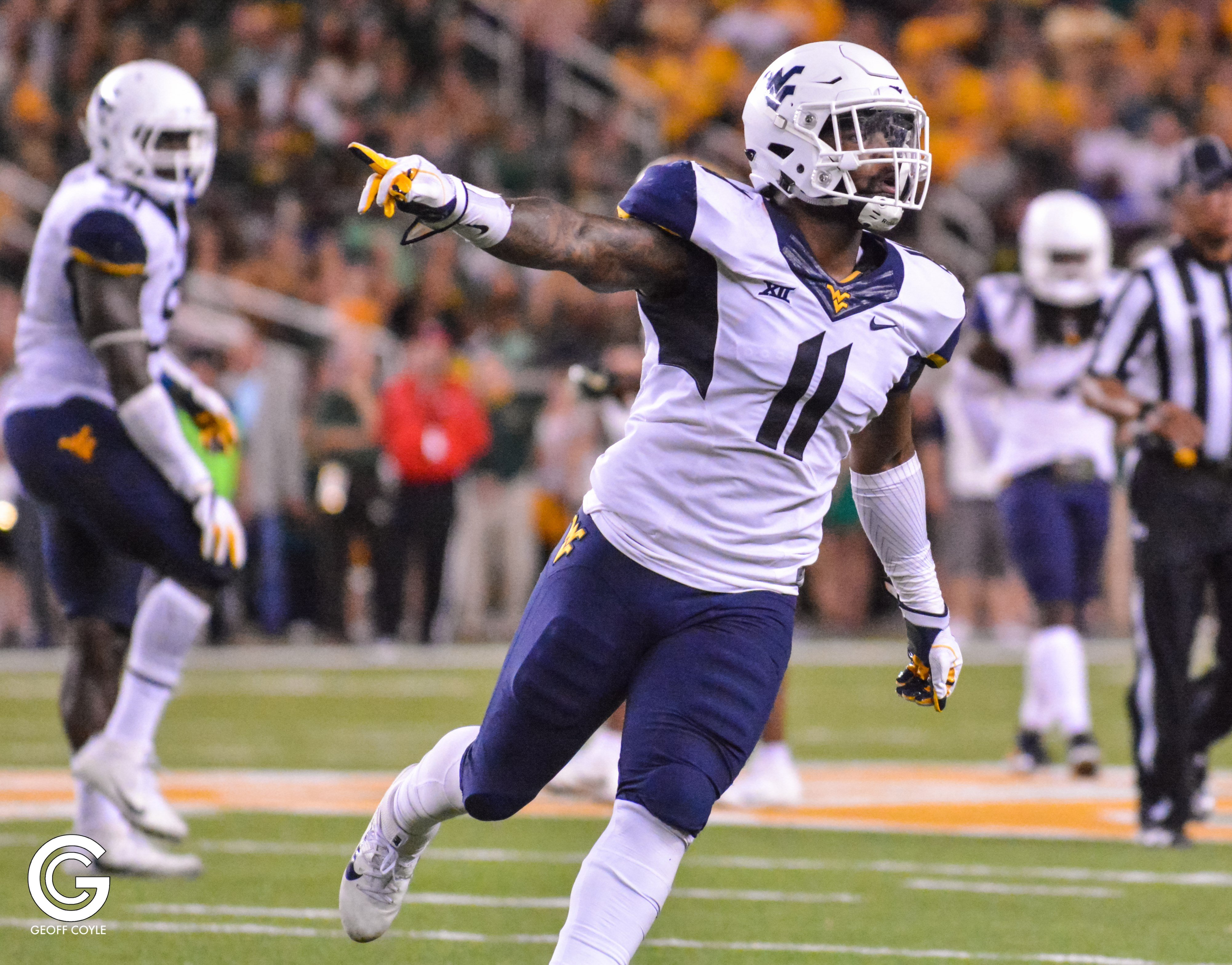 David Long celebrates during a WVU victory over Baylor. (PHOTO: Geoff Coyle)