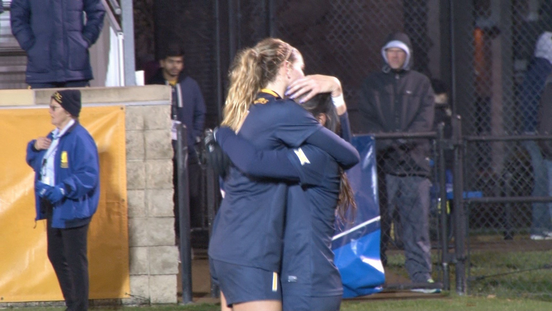 Grace Cutler and Carla Portillo share a hug after WVU's Sweet 16 loss to Penn St.