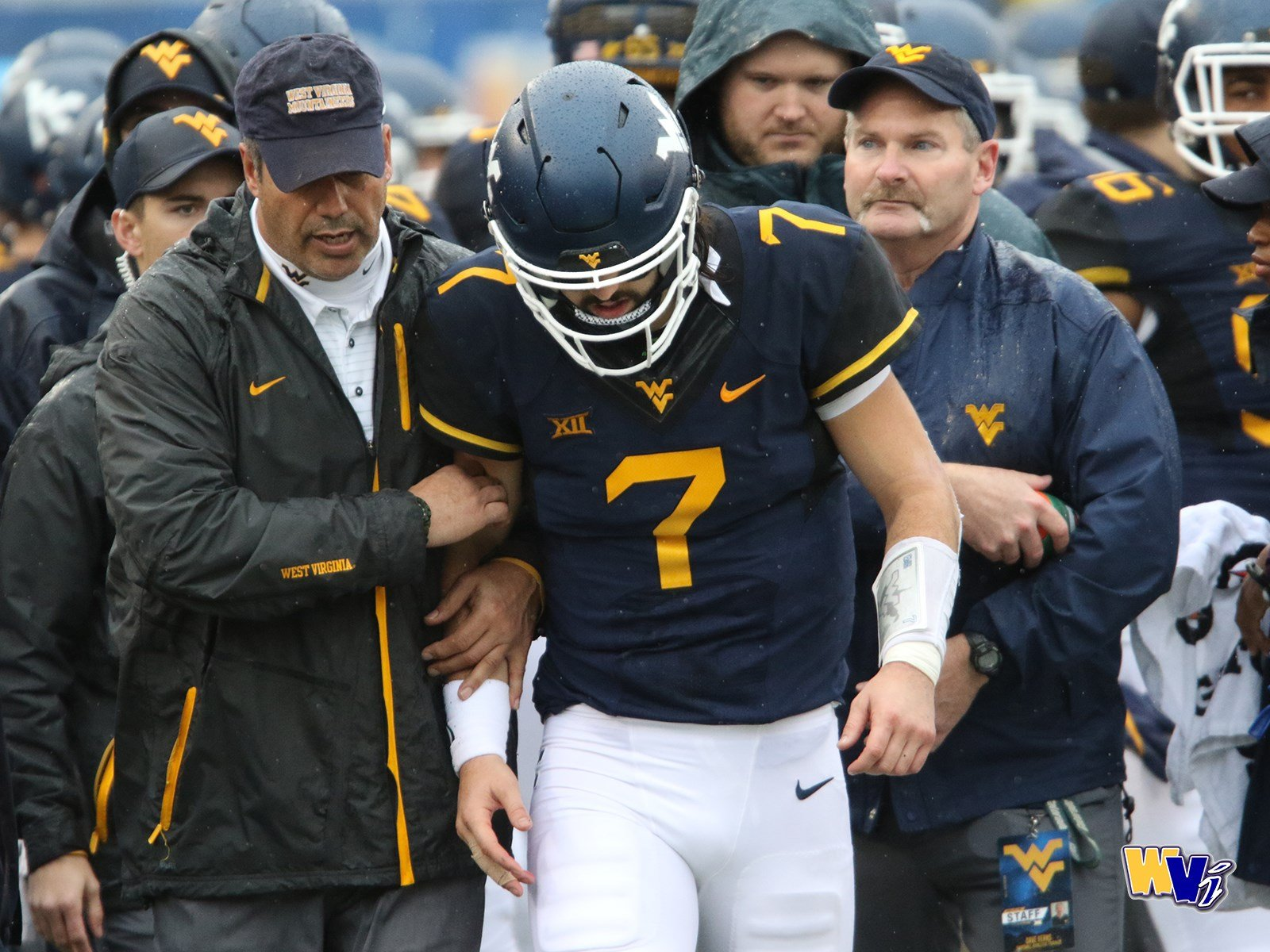 Will Grier heads to the locker room after disloacting his finger on Saturday. (PHOTO: Scott Lituchy)
