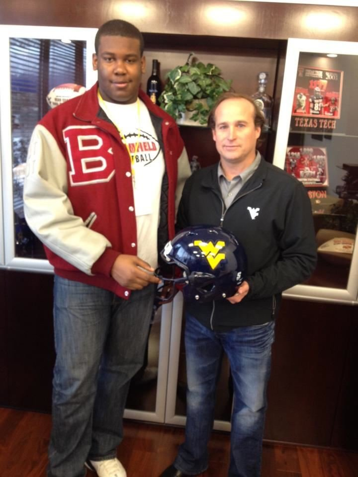 Marcell poses with Holgorsen during a previous visit to campus.