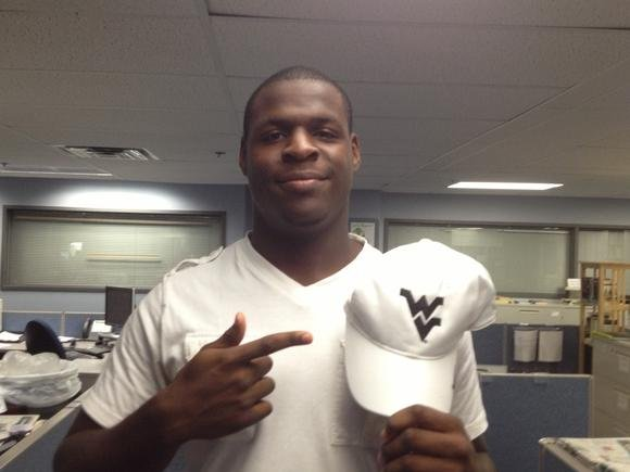 Tyree Owens shows off his WVU hat after committing this evening (photo courtesy of OrlandoSentinel.com).